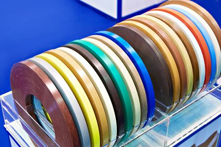 Colored plastic films for the end face of furniture panels