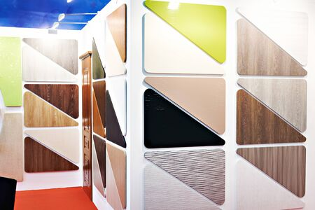 Samples of wooden and plastic furniture panels in shop