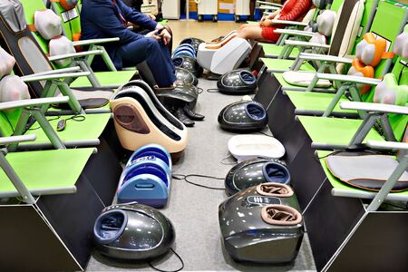 Chairs and automatic foot massagers Banco de Imagens