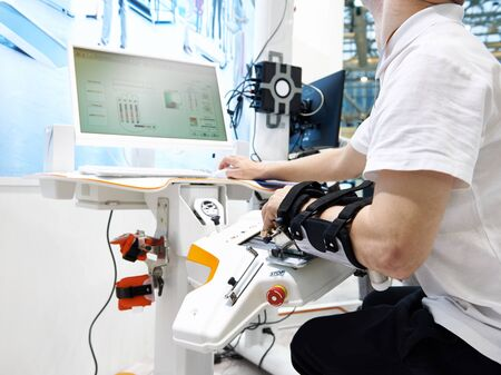Robotics and sensor-based rehabilitation devices for use with either hand