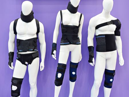 Mannequins with medical bandages on parts of the body Banco de Imagens