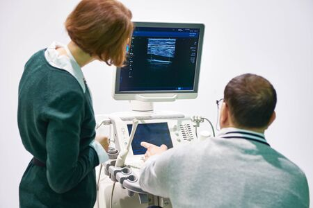 People near medical devices for ultrasound examination Banco de Imagens