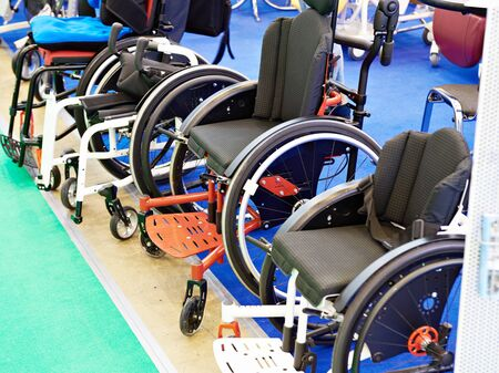 Wheelchairs for children on exhibition store Banco de Imagens