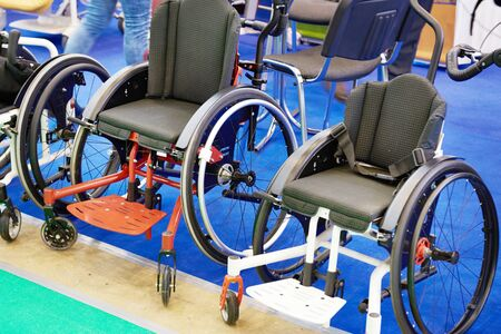 Wheelchairs for sport on exhibition store