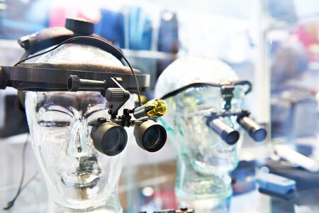 Optical medical equipment on dummy head in store