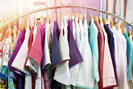 Medical gowns for nurses on a hanger in a store