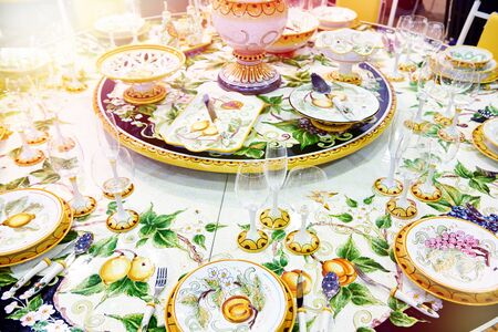 Festive table for a gala dinner with beautiful tableware