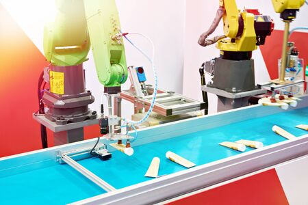 Automatic robot manipulators factory and plastic tubes Foto de archivo