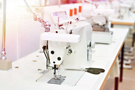 Embroidery industrial machine in sewing workshop