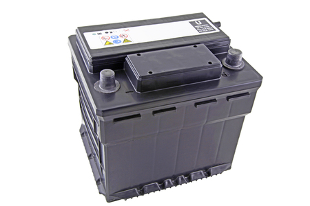 twelve volt battery – An isolated black non maintained car battery on a white background