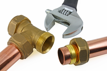 plumb: Plumbing – A view of a compression joint.  Pipe, nut,olive and brass fitting on a white  background