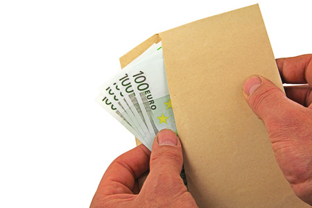 Money – A pair of hands holding and spreading out one hundred euro notes in a brown envelope Stock Photo