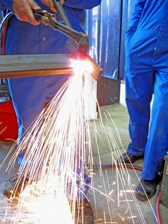 Oxy fuel cutting – A welder cutting up metal using oxyaceteylene  cutting torch Stock fotó