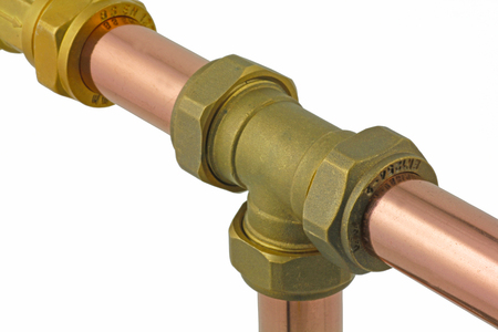 plumb: Copper pipework –  Three sections of copper tubing  connected to a compression tee isolated on a white background,