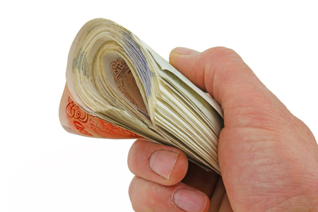 Money notes – A male hand holding a large amount of sterling pound notes isolated on a white background Stock fotó