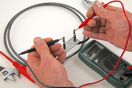 Appliance testing – An engineer fault finding an electric  oven heater element. Stock Photo - 91723446