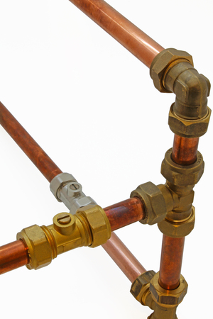 Copper pipework –  Copper pipe, compression and solder fittings isolated on a white background,