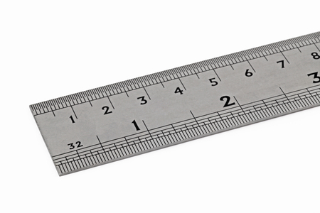 steel rule – A plan view of a steel ruler showing metric and imperial measurements isolated on a white background Stock fotó
