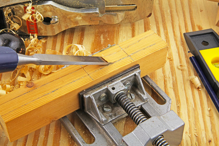 Carpenter tools – A carpenter using a chisel on wood