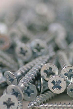 Screws – A close up on a pile of screws with a blurred background