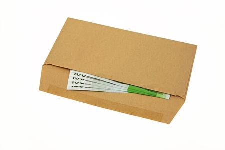 Envelope – A brown open envelope containing four, hundred euro notes Stock Photo
