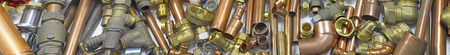 Plumbers pipes and fittings website banner  –  Wide  random mixture of copper pipe and brass fittings ideal for use as a website header  background