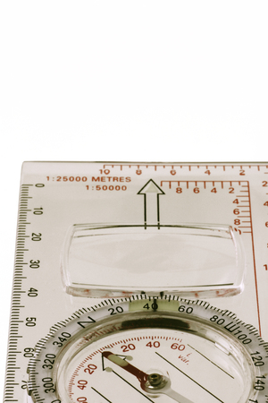 Plastic magnetic compass – A plan view  of  a see through magnetic compass isolated on a white background Banque d'images