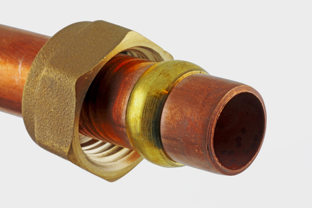 Plumbers fitting – A close up view of a compression fitting isolated on an off white background Imagens