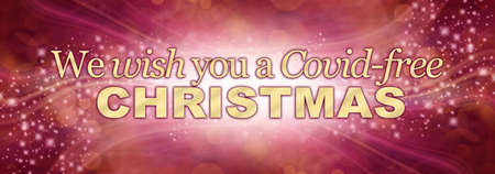 We wish you a Covid-free Christmas Web Banner – warm gold and plum coloured wide bokeh website header Banque d'images