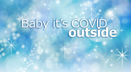 Baby it's COVID outside concept background - pale blue wintery sparkling cool background with the words Baby it's covid outside Banque d'images