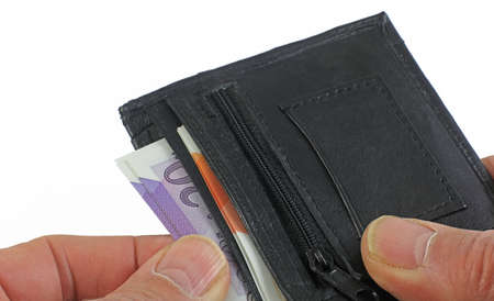 A set of hands holding and removing money from a black wallet Banque d'images