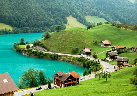 chalets: View from above of a village by lake Brienz, during springtime. Near Meiringen, Switzerland.