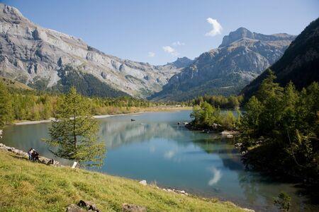 Lac de Derborence mountain lake in the Valais Alps. photo