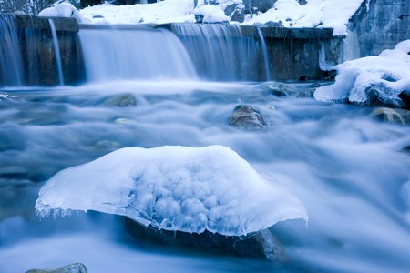 mountain stream: Naturally shaped ice sculpture in a mountain stream. Stock Photo