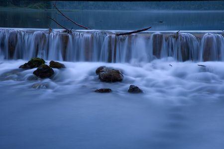 abstractly: Water cascade at Lake Dobbiaco. Stock Photo