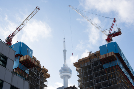 Toronto construction site with two cranes and on sunny day