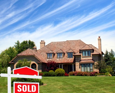 Beautiful house and sign sold Imagens