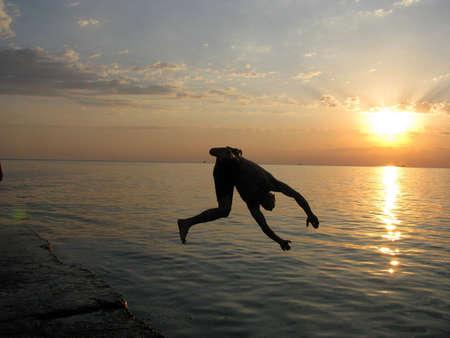 backlit, seascape, waterscape,flight, levitation Stock Photo - 3829532