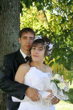 ; bright wedding; love; newlywedses; shyness; bride; bridegroom; bouquet; embraces, people; family; holiday; pair; spouses; happiness; romanticism; gold(en) autumn Stock Photo - 4059077