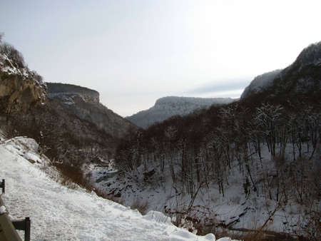 Canyon, winter; gorge, wood, snow; relief, nature; landscape;  frost; journey; mountain type; sky; background; beauty; Caucasus, spine photo