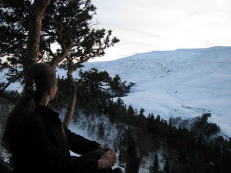 The winter, plateau, mountains, a kind, a panorama, a landscape, the nature, a landscape, snow, wood, the Alpine meadows, a relief, caucasus, beauty, a background, reserve, a slope, flora, a ridge, clouds, the sky, a pine, the girl, grief, grief, sits
