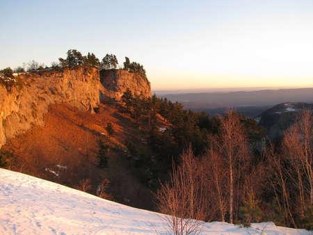 Vegetation; rocks; a relief; a landscape; a hill; a panorama photo