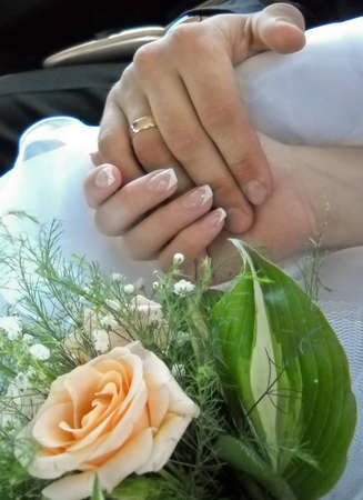 Wedding rings and bridal bouquet photo
