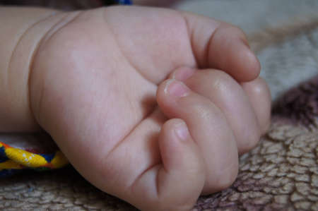 childs little hand Stock Photo