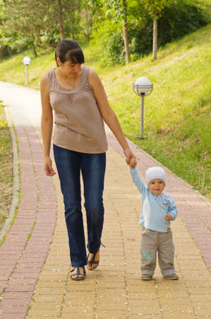 Mother and son walking in the park photo