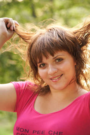 The young cheerful girl on walk Stock Photo