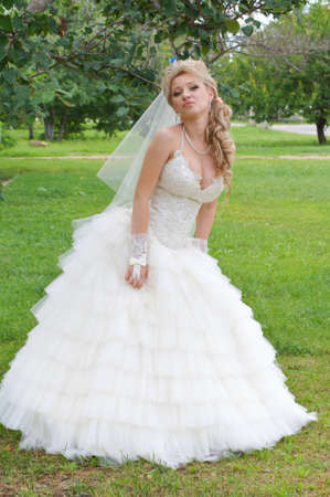 The young beautiful wife in the wedding day photo