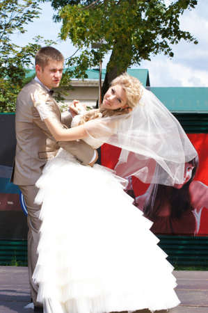 Young married couple in the wedding day photo