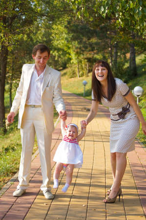 Young happy family on walk photo