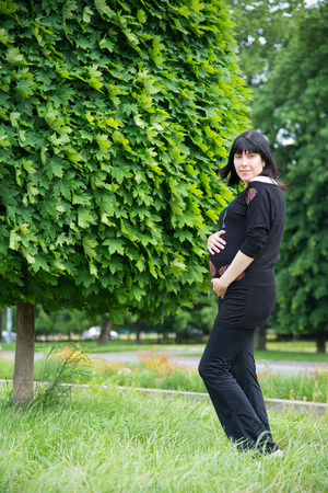 paunch: The pregnant girl on walk in city park
